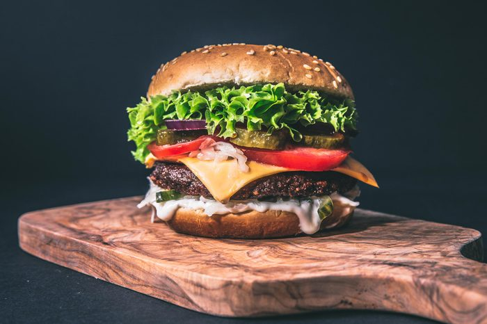 delicious burger on artisan wood cutting board