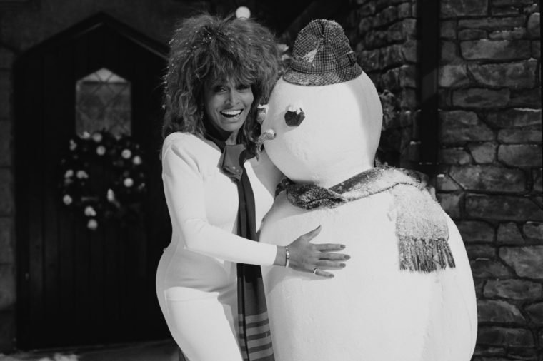 American singer Tina Turner with a model snowman, circa 1980