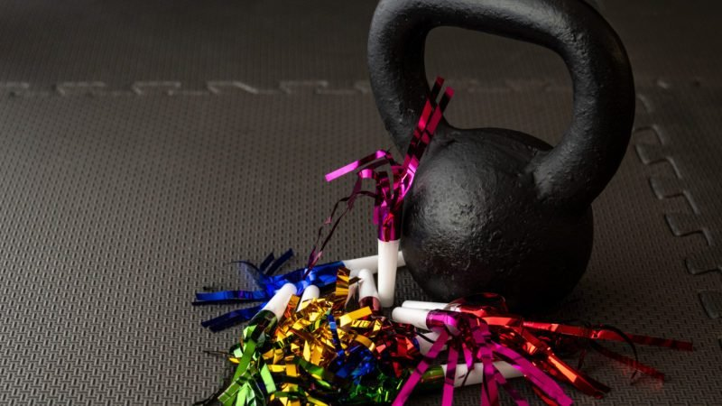 Black kettlebell on a black gym floor noisemakers new year