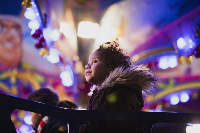 close up of a child in awe on a carnival ride
