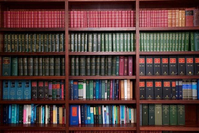 A bookshelf containing volumes of books