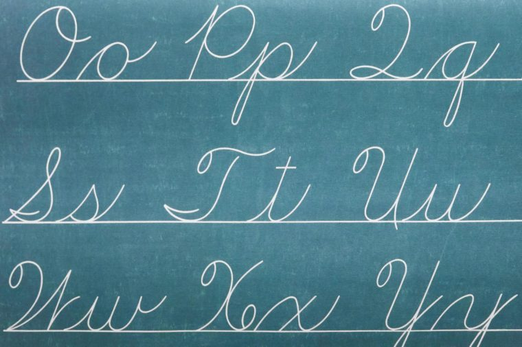 cursive letters of the alphabet written on a chalkboard