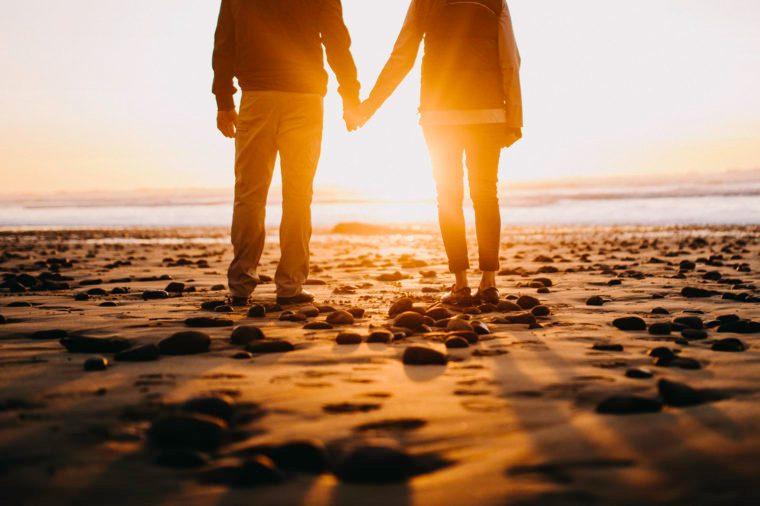 Loving Mature Couple shore beach At Oregon Coast