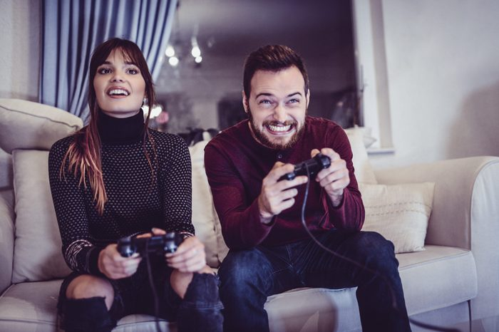 Couple Competing In Video Games At Home
