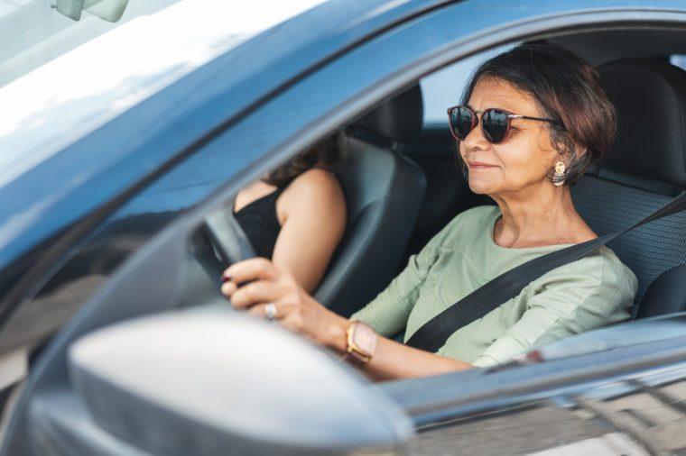 woman driving a car calmly