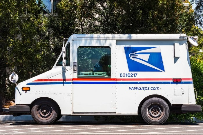 USPS vehicle parked on the side of the road