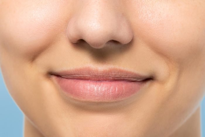 close up of woman's face, mouth, and nose