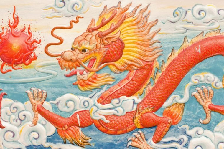 traditional chinese dragon wall sculpture on a temple wall
