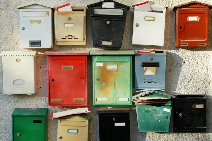 Letter boxes at the entrance of a building with apartments.