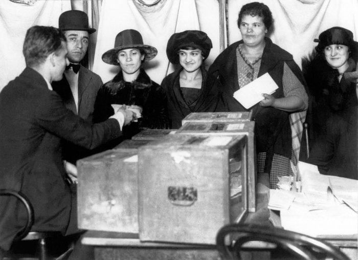 women standing in line to vote