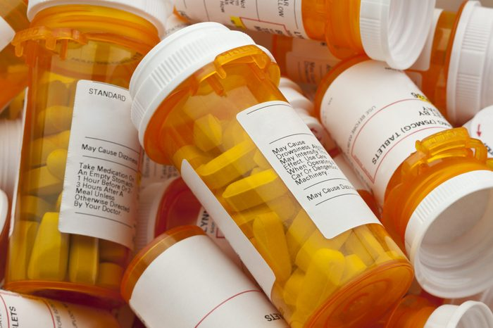 Bottles of prescription medicine in a pile.