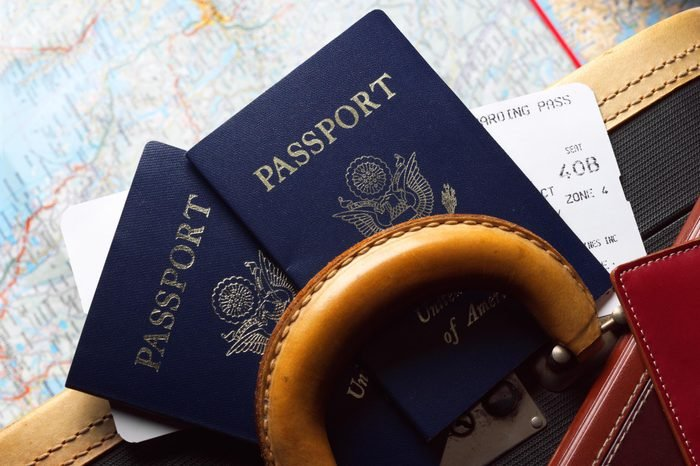 two passports, a boarding pass, a suitcase, and a map