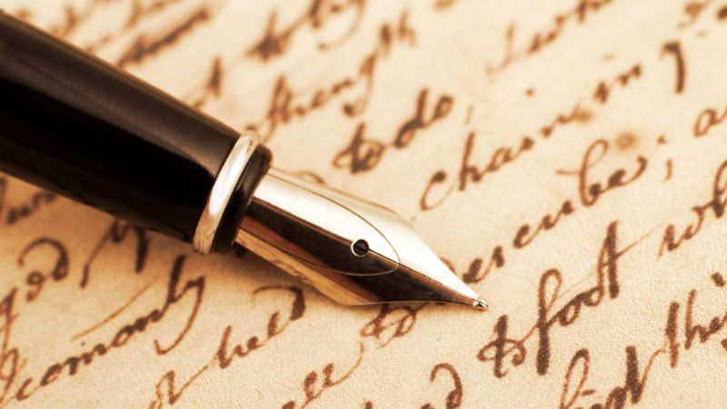 calligraphy fountain pen and letter close up
