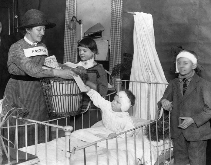 1926: Children at St Bartholomew's Hospital, London, receiving their post.