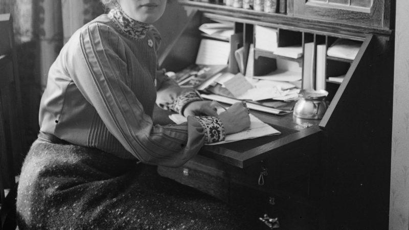 woman at a writing desk at home. circa 1905