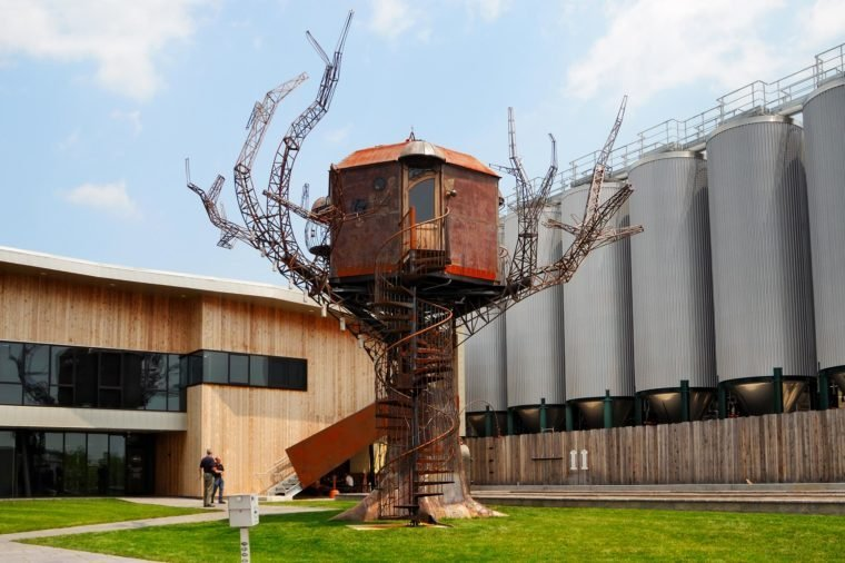 Dogfish Head Brewery, Milton, Delaware, Tree House Sculpture and Fermentation Tanks