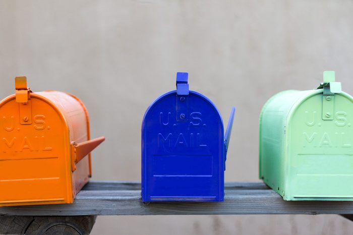 Three colorful mailboxes rural mailboxes.
