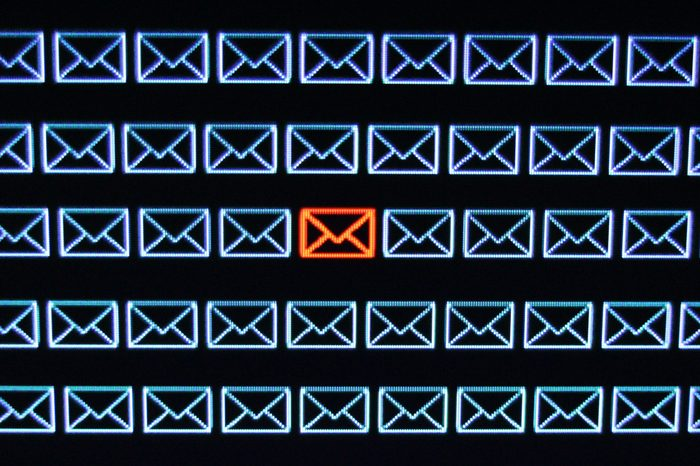 email icons on a screen. all blue except one red one in the center.