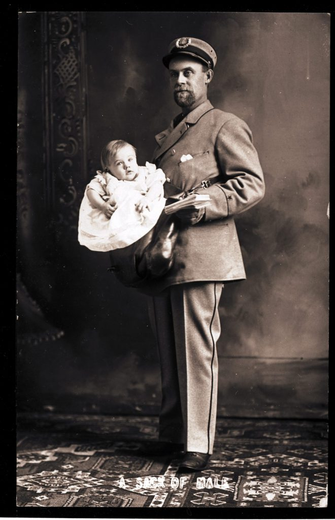 A US postman carrying a baby boy along with his letters, USA, circa 1890.