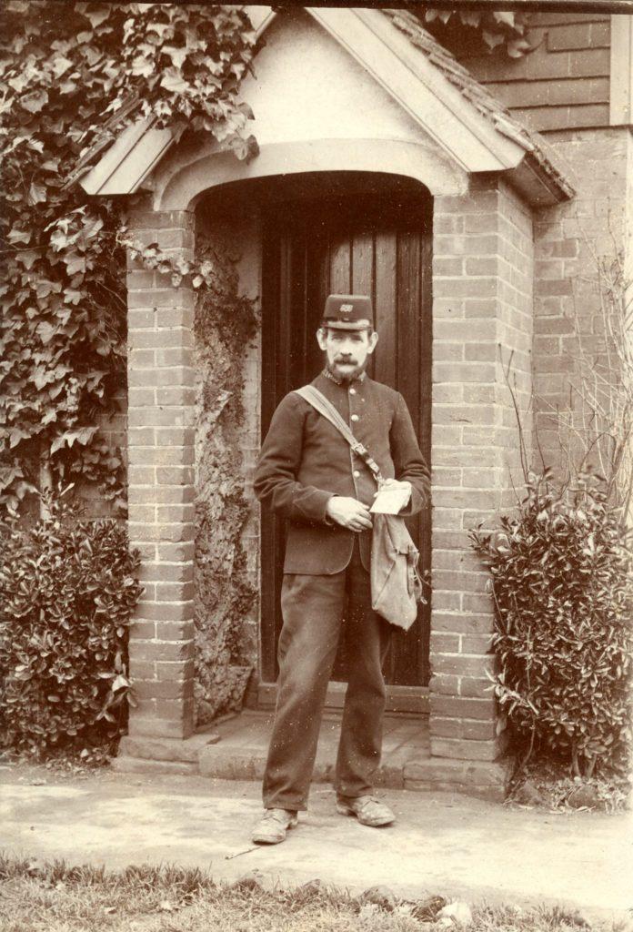 A postman, circa 1920.