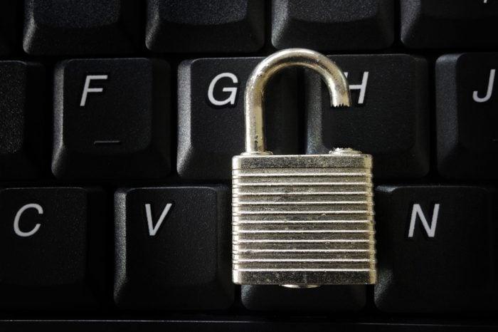 Broken lock on a computer keyboard -- data security concept