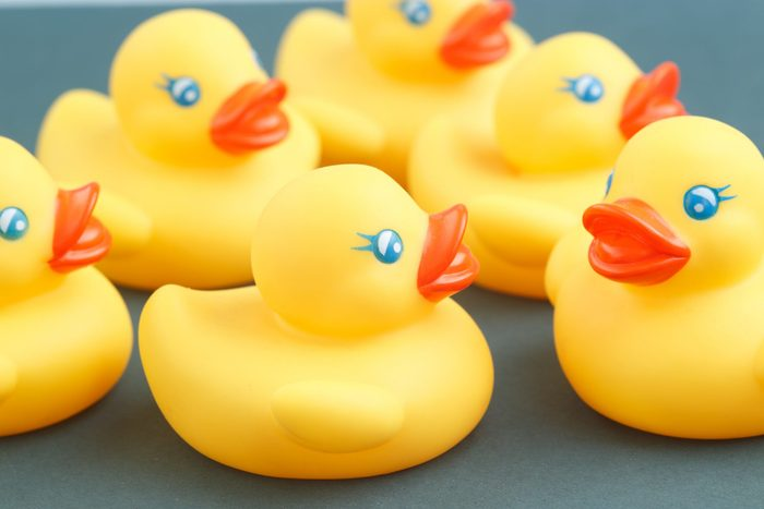 Yellow rubber ducks close up photography.