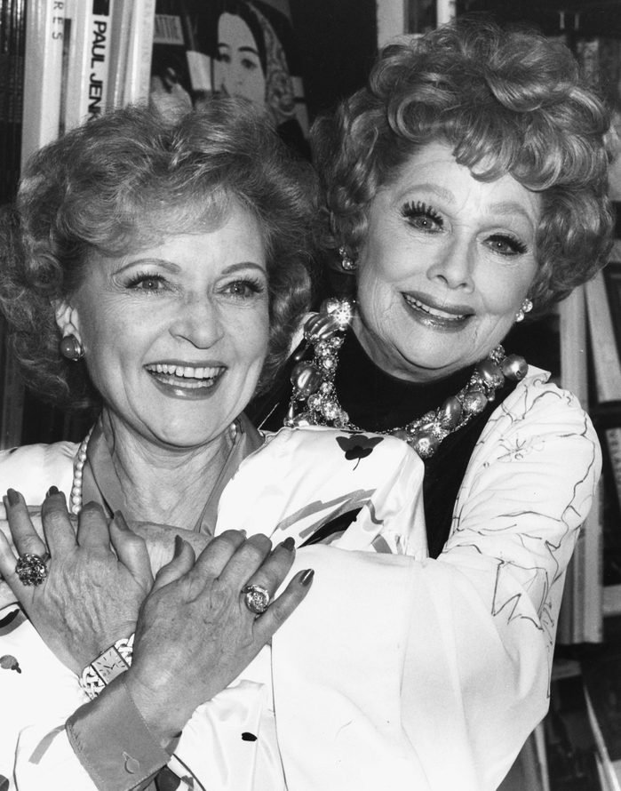 Actresses Betty White (left) and Lucille Ball embracing at a book signing event in Los Angeles, October 2nd 1987.