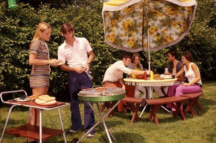 1970s GROUP TEENAGERS BOYS GIRLS BACKYARD GRILLING TABLE UMBRELLA