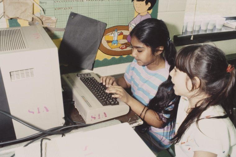 Two children using a computer in school, USA, May 1984