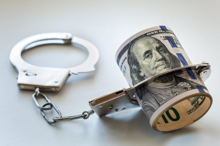 roll of money in handcuffs