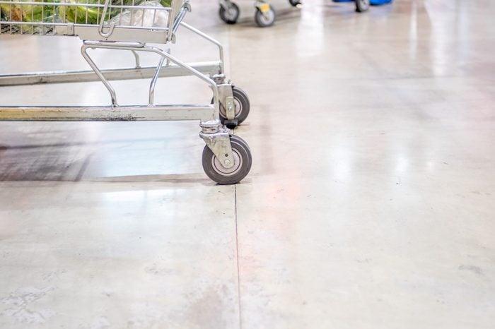 Close up shopping cart wheel at supermarket.