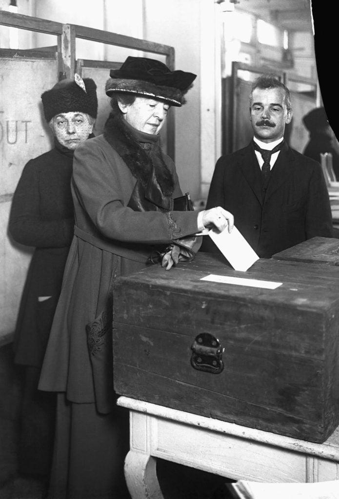 maud powell places ballot into ballot box voting