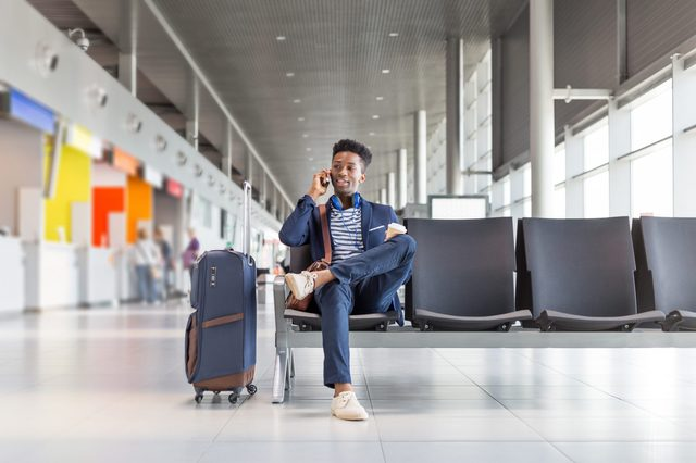 young man on the phone in a airport