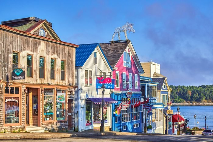 Old Wooden store buildings on waterfront at the town of Bar Harbor in Acadia national Park, Maine, USA
