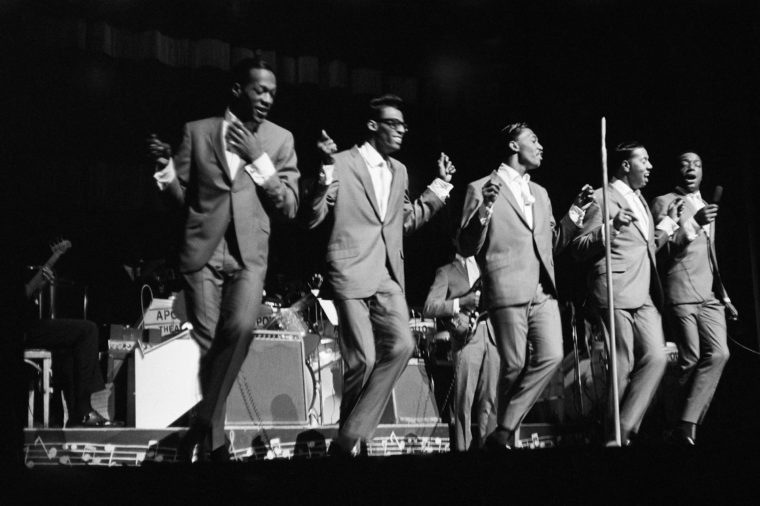 "NEW YORK - 1964: L-R: Paul Williams, David Ruffin, Otis Williams, Melvin franklin and Eddie Kendricks of the R&B group ""The Temptations"" perform onstage at the Apollo Theater in 1964 in New York City, New York"