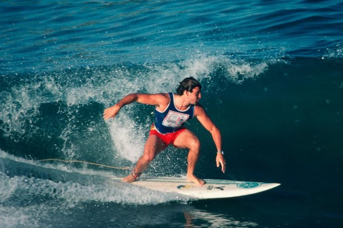 HUNTINGTON BEACH, CA - 1983: A surfer competes in the 1983 Huntington Beach, California, United States Surfing Championships
