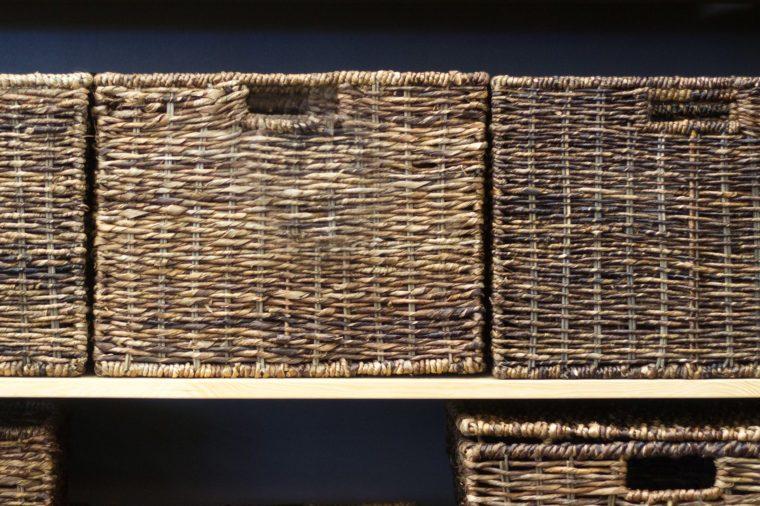 baskets lined up on a shelf