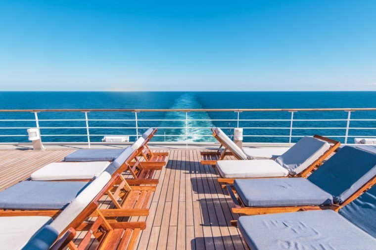cruise ship at sea. desk with lounge chairs.
