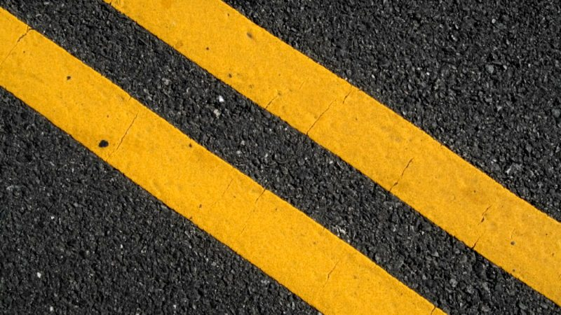 Double yellow lines on street.
