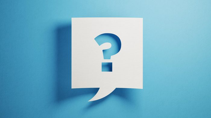 White chat bubble on blue background. There is a question mark symbol on chat bubble.