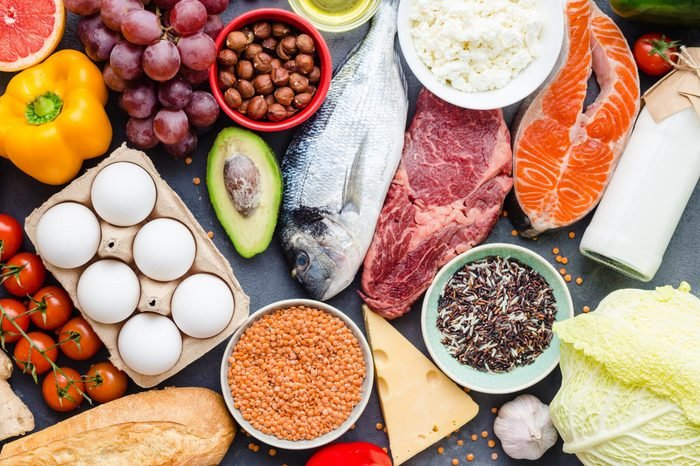 Healthy nutrition concept. Meat, fish, vegetables, fruit, beans, dairy products. Top view overhead.