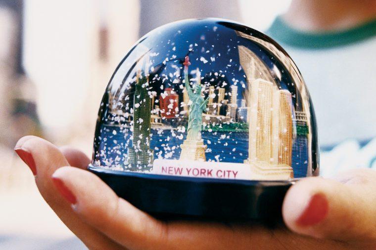 hand holding new york city snowglobe