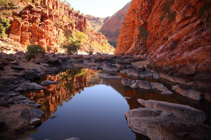 Ormiston Gorge in the West MacDonnell Range reflected in a pool of water.