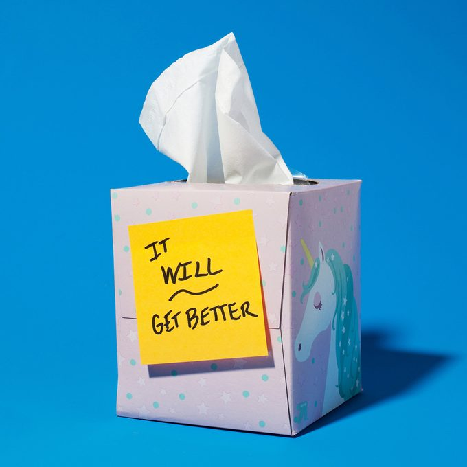 """tissue box with a post it note that reads """"it will get better."""" blue background"""