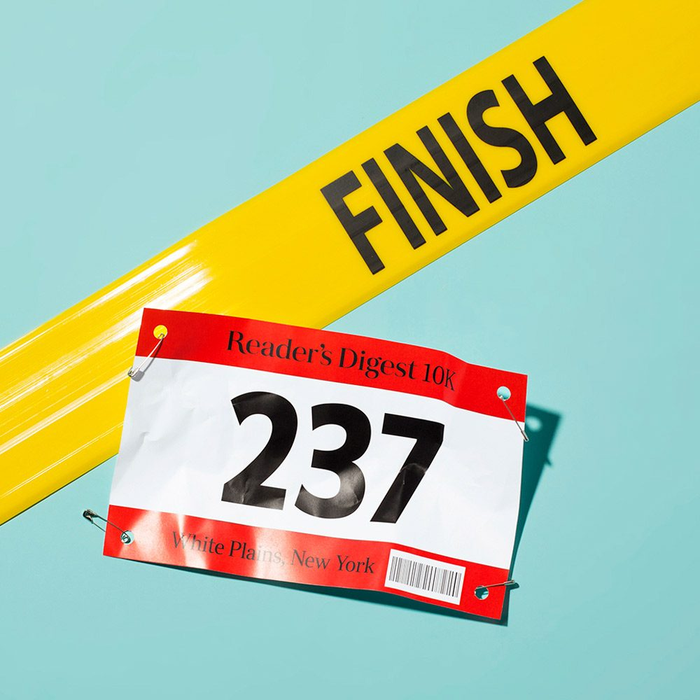 race bib and finish line on light green background