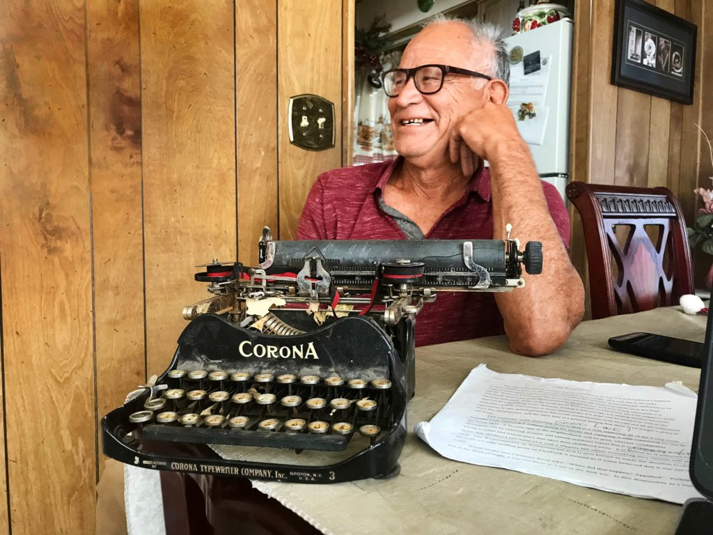 Jerry Valencia with his Corona typewriter in his home