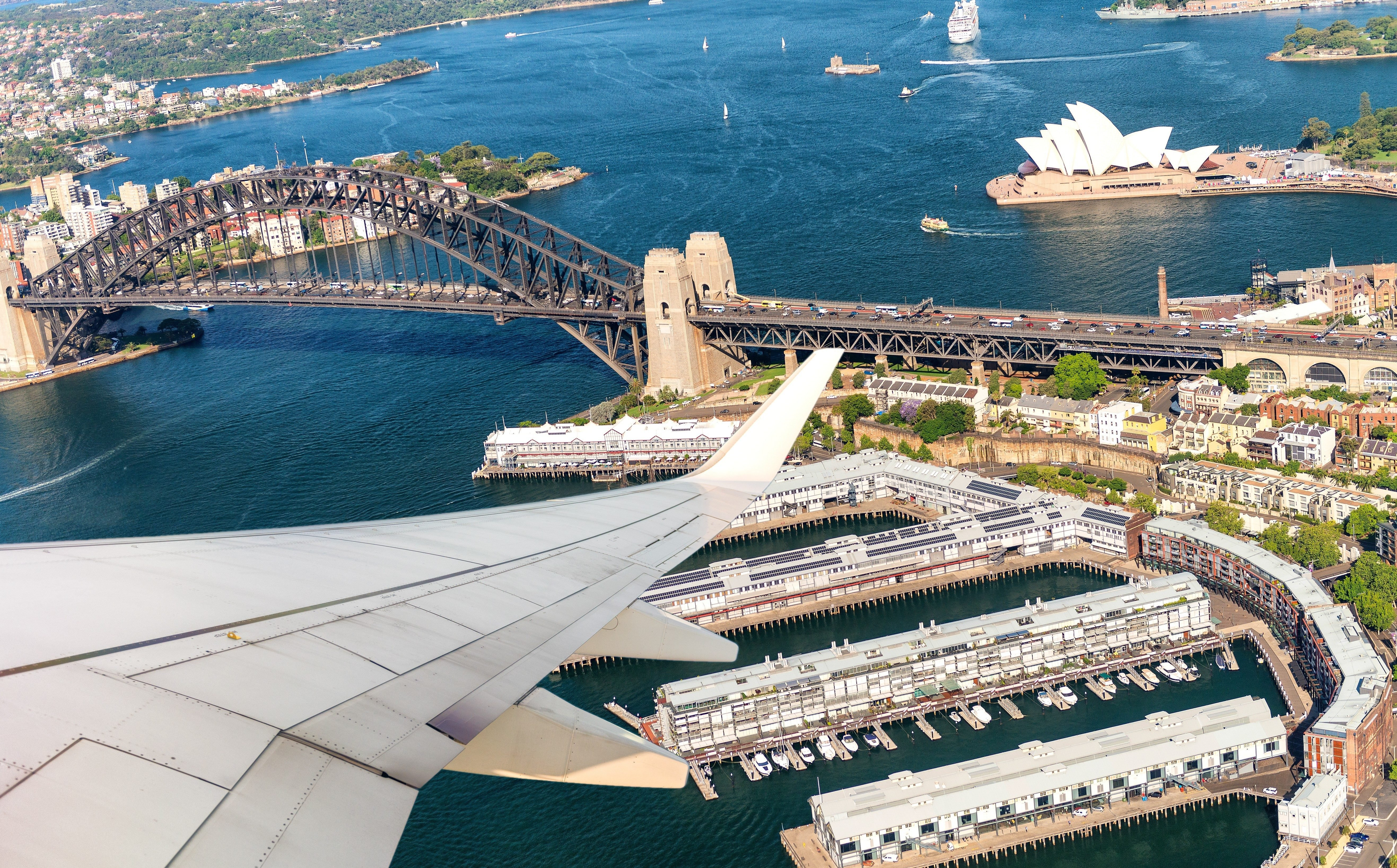 Airplane flying over Sydney. Tourism concept.