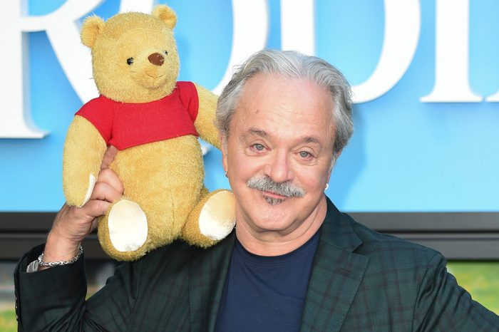 Jim Cummings holding a winnie the pooh stuffed animal at the london 'christopher robin' film premiere, 05 aug 2018