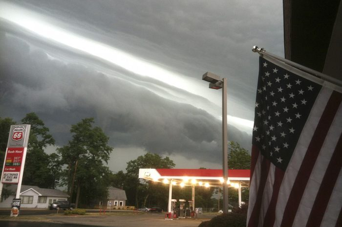 A shelf cloud on the leading edge of the derecho long, flat clouds