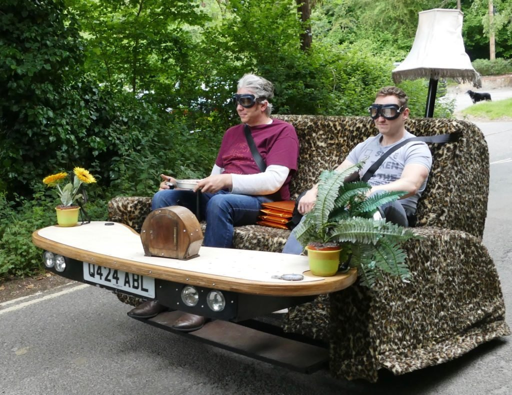 Edd China and friend ride his sofa car down the road